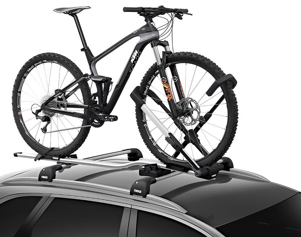 De Thule fietsendrager Upride voor op het dak van de auto.Universele staande fietsendrager zonder contact met het frame, voor een snelle en veilige montage en maximale bescherming van het frame